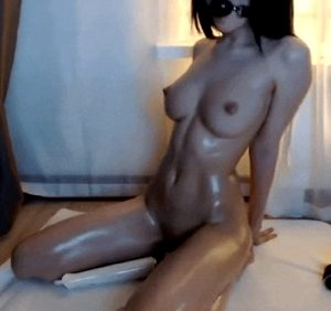 Busty babe with ballgag and vibrator playing on webcam